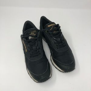 Reebok black and gold athletic shoe